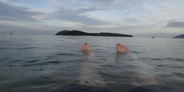 Floating in the beach at Pantai Cenang, Langkawi, Malaysia Feature