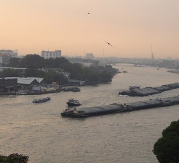 A hazy and beautiful sunset over looking the Chao Phraya River in Bangkok