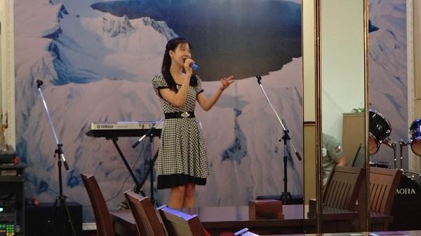 Phnom Penh - North Korean Pyongyang Restaurant - Our Waitress Singing English Songs