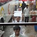 Siem Reap to Battambang - Mr Thien our Tuk Tuk Driver Holding Up The Sign From Battambang My Homestay