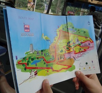 Tanya Holding The KL Hop On Hop Off City Bus Tour Map