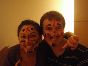 tanya and andrew with their faces painted by their students