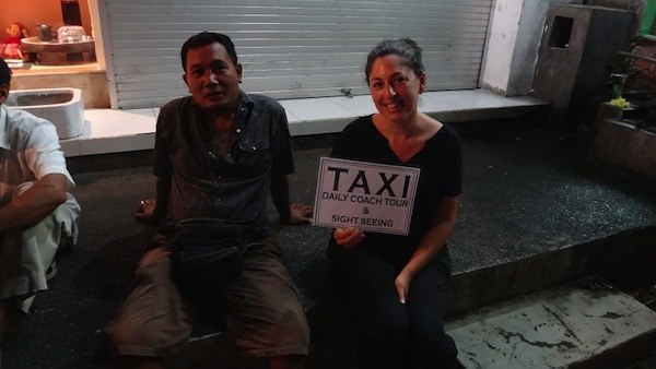 Taxi Driver And His Sign In Ubud
