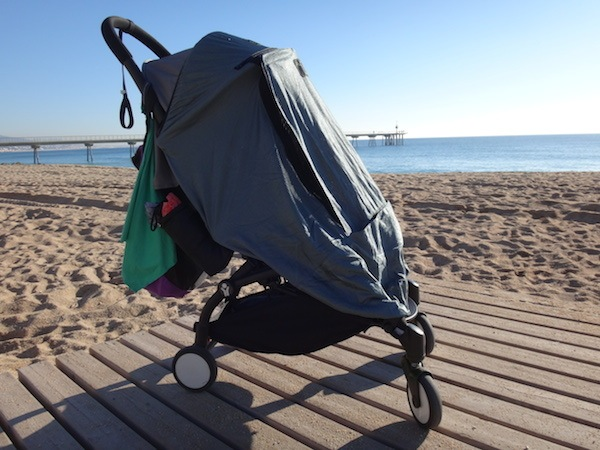zoe in her yoyo plus snoozeshade on badalona beach in spain