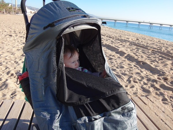 Zoe in her Babyzen Yoyo with Snoozeshade at Badalona beach near Barcelona