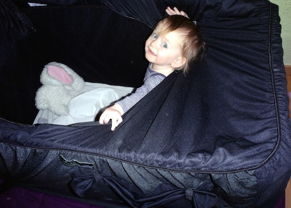 Zoe Playing With The SnoozeShade On The Traveller Travel Cot