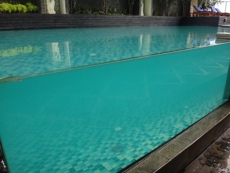glass sided swimming pool at Grand Swiss-Belhotel Medan